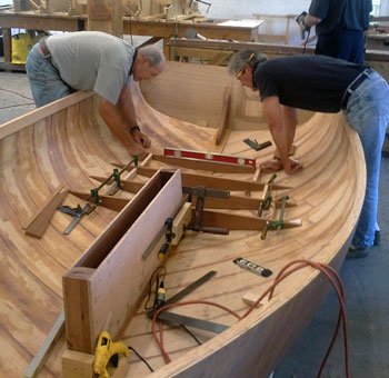 Boat building in the shop.